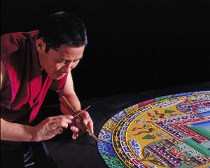 monk creating a mandala